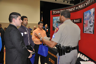 SHSU Seniors David Miniel (center) and Sebastian Mata (r) chat with the Texas Department of Public Safety during the CJ Career Fair.