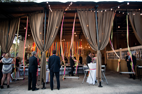 Gray curtains lined the reception tent interspersed with multicolored