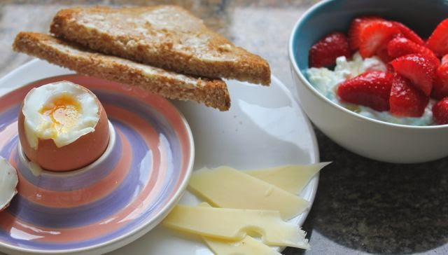 Breakfast, eggs, cheese, toast and fruit with yoghurt