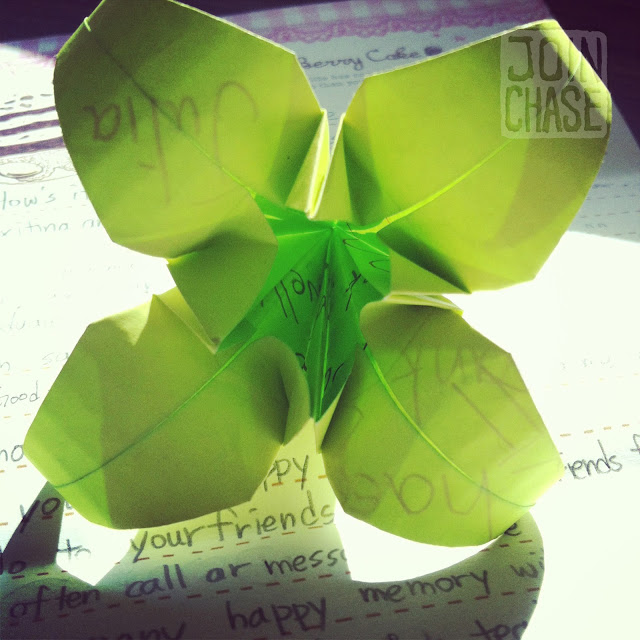 A paper flower and handwritten note made by a student.