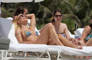 Michelle Hunziker sunbathing