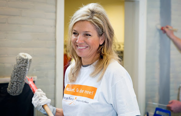 Queen Maxima laughs as she paints a wall in the sports area of a cultural centre in the village Tricht, on March 21, 2015. Members of the Dutch royal family take part in the national voluntary event NLdoet.