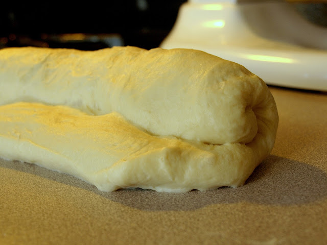 rolling up bread dough