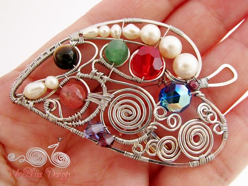 Wire wrapped leaf brooch with gemstones by WireBliss