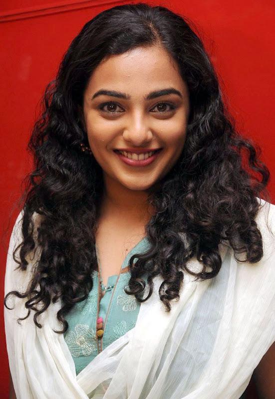 Nithaya menon Cute Stills in  tamil Movie Press meet new Photos cleavage
