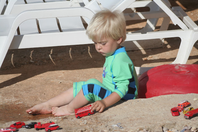 Anton playing with cars.