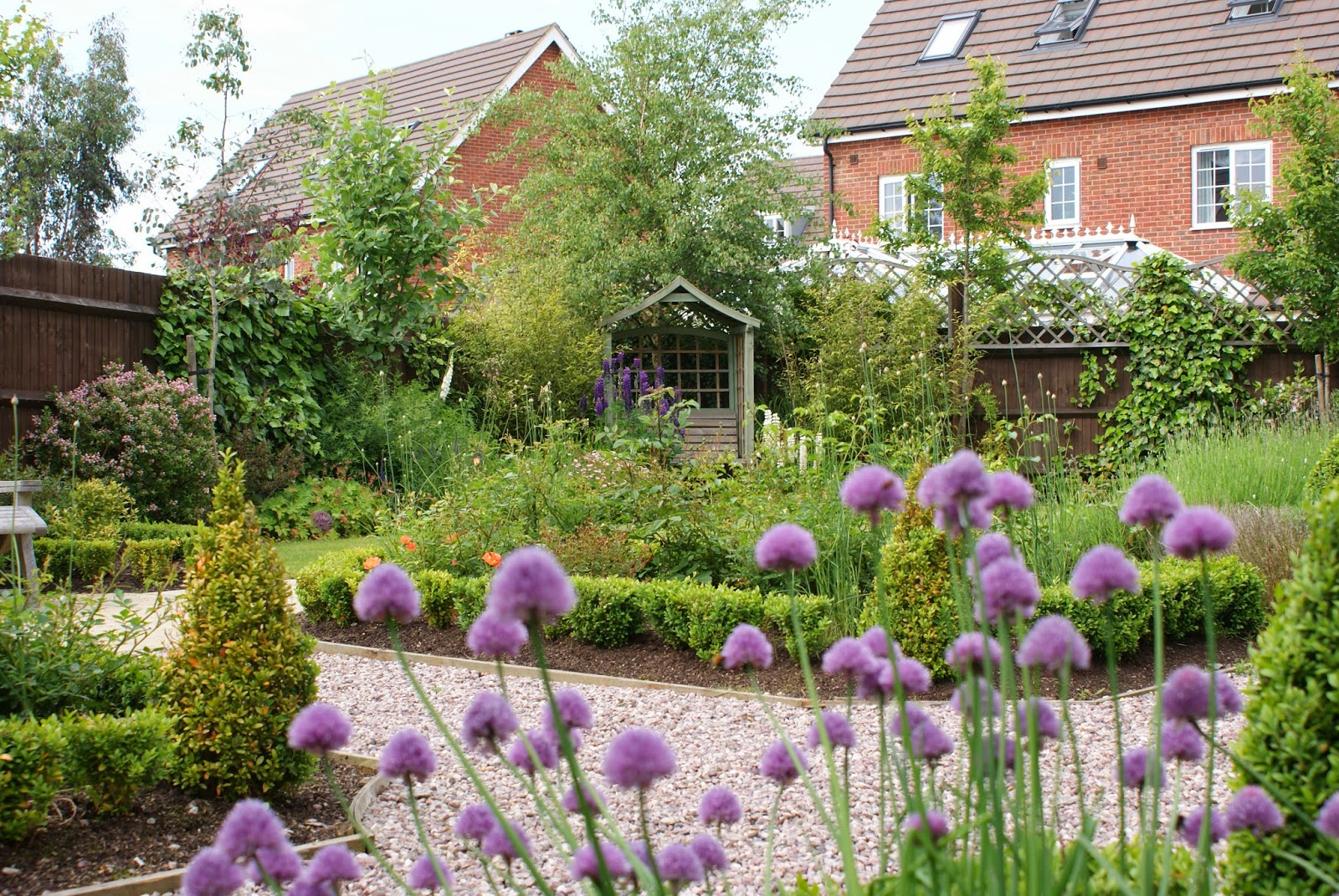 Traditional garden design with flower borders garden for Formal garden