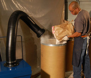 A Sentry Air powder containment unit removes dust from the worker's breathing zone.