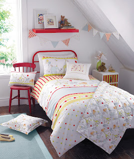Kirstie Allsopp Circus Parade Children's Bedding. Giraffe's and Elephant's parade across this duvet cover set.