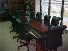 Conference Room Table With Granite Around The Perimeter And Wood In The  Center.