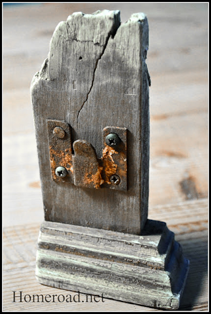 A reclaimed lumber and rusty hinge picture frame by Homeroad, featured at I Love That Junk