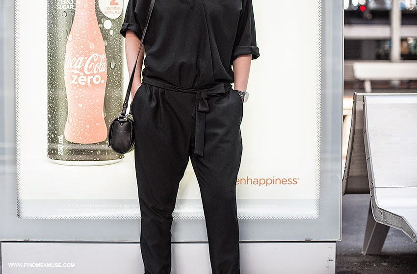 Mandi from Find Me A Muse blog wearing ASOS jumpsuit Givenchy Obsedia quilted leather bag in front of coke sign