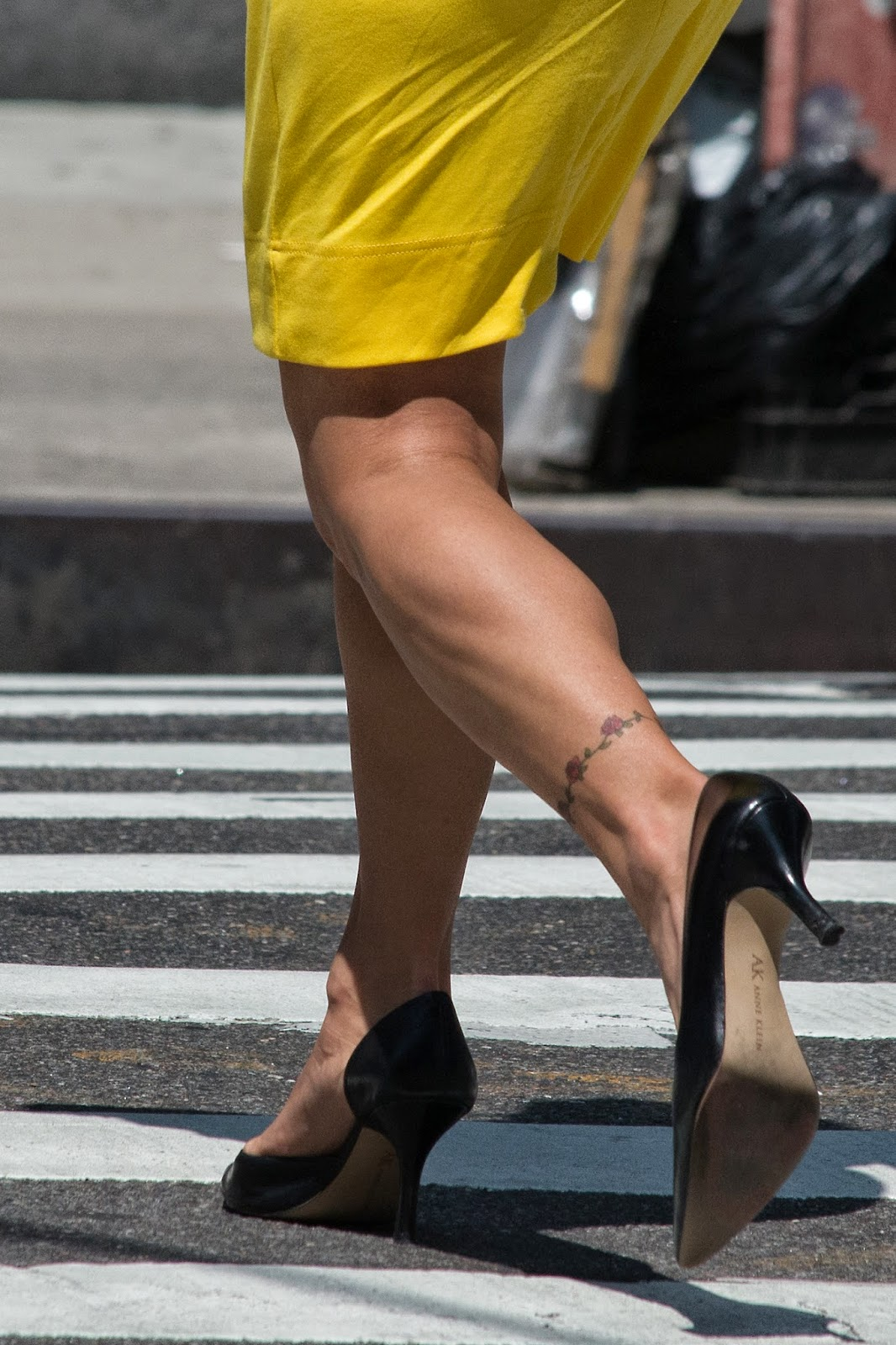 muscular calves and heels on the street