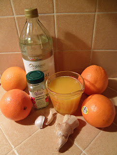Oranges, orange juice, dried basil, garlic, ginger, white vinegar