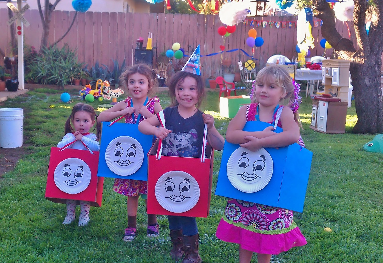 I bought small moving boxes and covered them with poster paper. My sister drew Thomas faces on paper plates. Then we inserted straps so the kids could wear ...  sc 1 st  Elizabeth Breton & Thomas the Train Birthday Party! - Elizabeth Breton