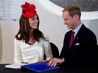 William and Kate, the Duke and Duchess of Cambridge, share a laugh after signing a guest book at a citizenship ceremony Friday, July 1, 2011, in Gatineau, Canada.