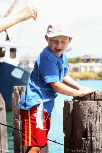Rylan Johnson, 5, Wellington, looking excited cos his Mum caught a fish on his new Christmas present fishing rod, fishing in the Iron Pot, Napier. photograph