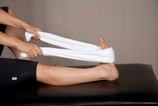 stretching calves with towel