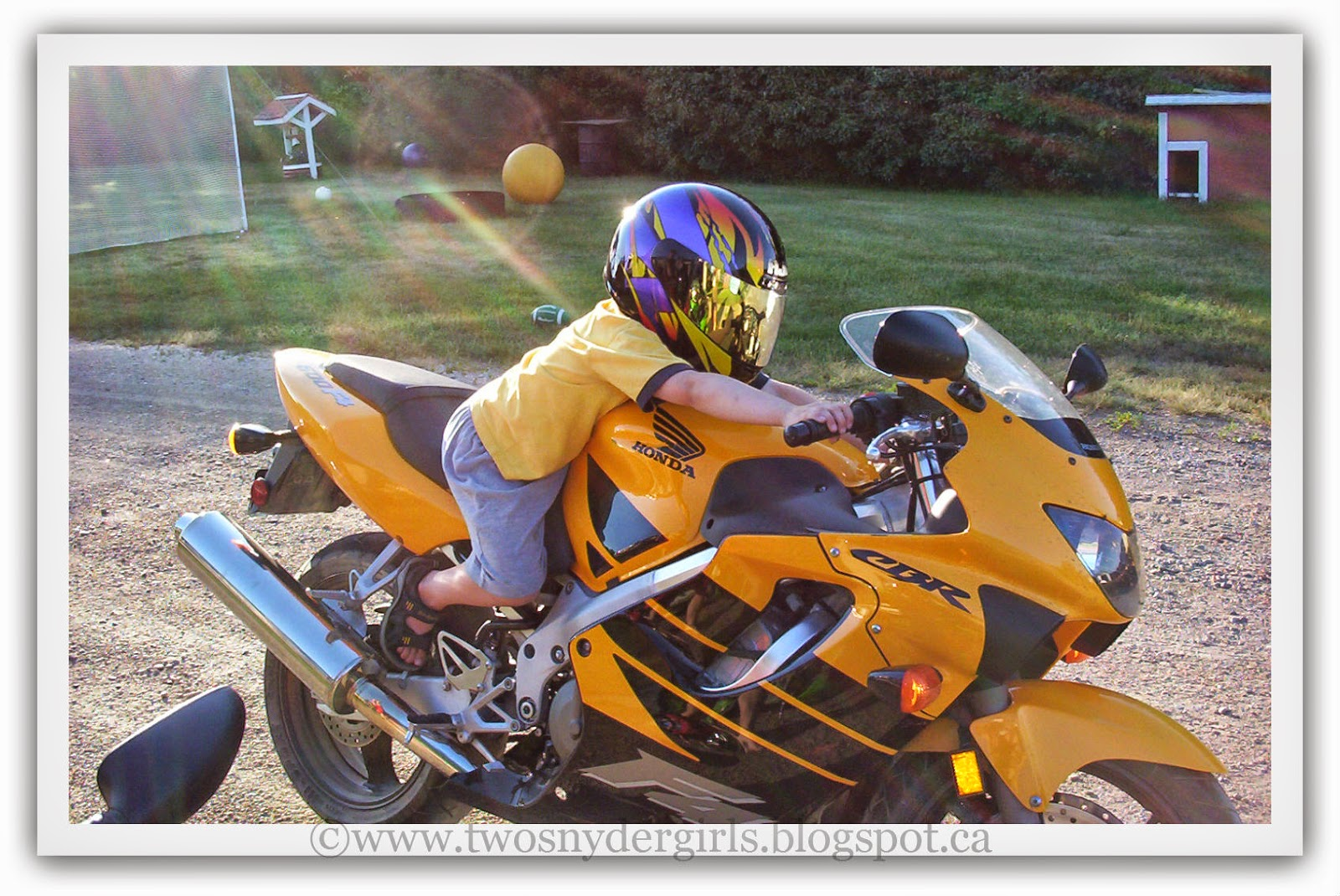 Child pretending to ride a motorcycle