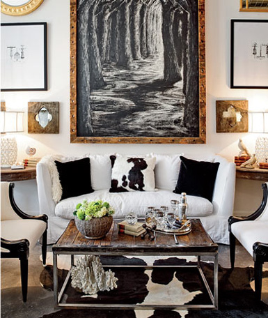 {A Large Painting In The Center, Flanked By Smaller Pieces Of Art, Photos,  Mirrors, Etc.}