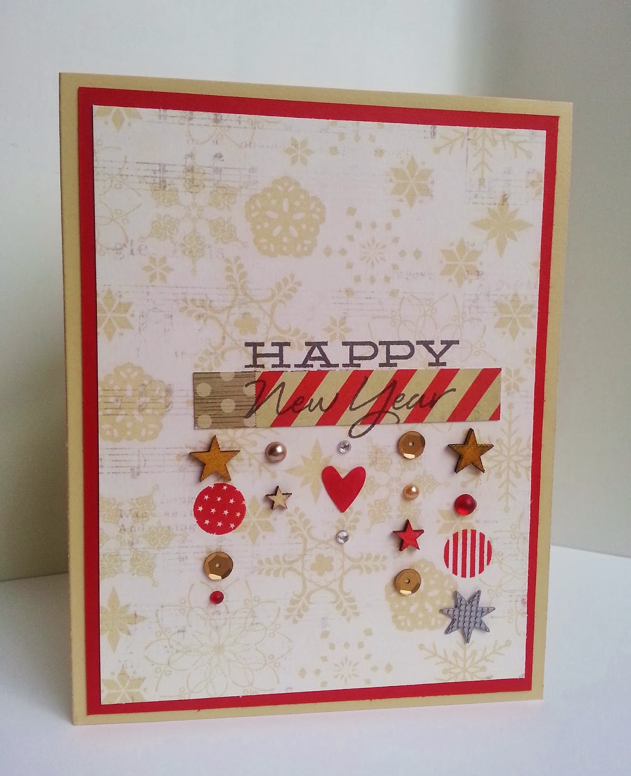 i decided to make a new year card with some fun christmaswinter paper i got on sale from heidi swapp the little piece that looks like washi is actually