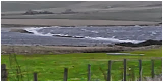 The Oyce almost vanishing at high tide in a gale.