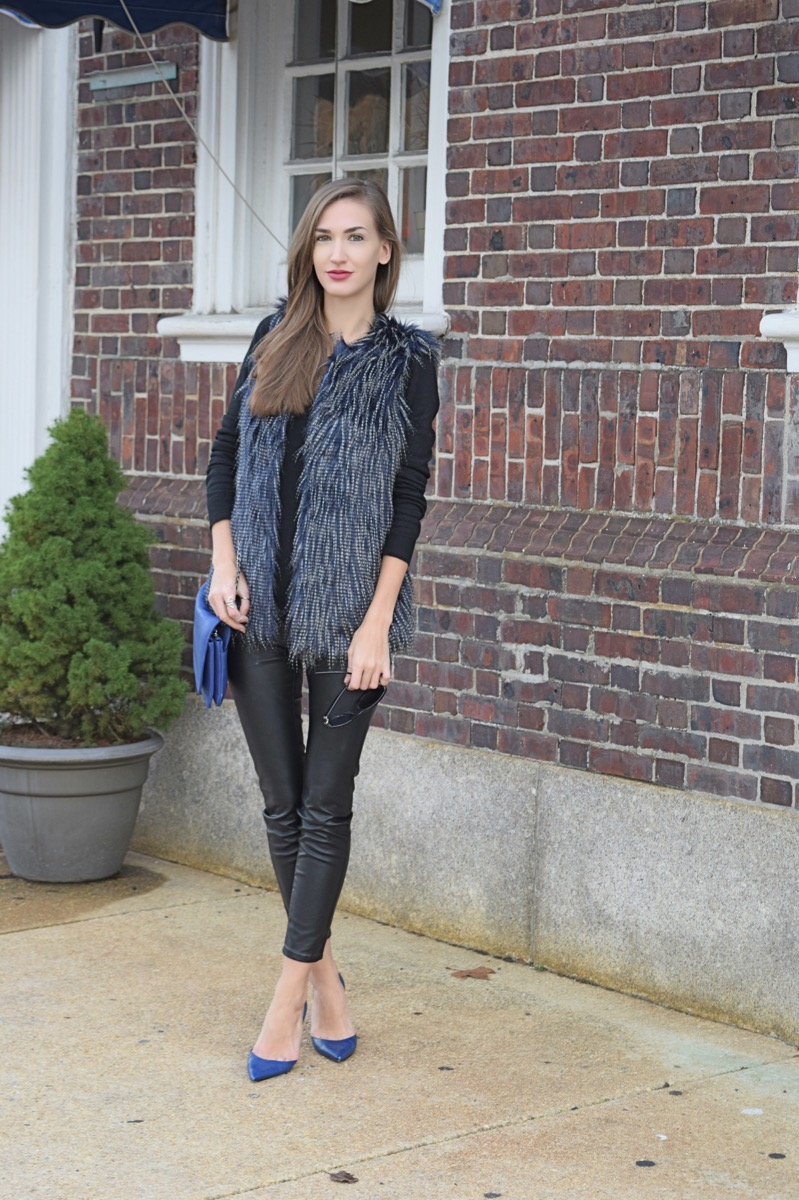 Wearing target black and blue mossimo shaggy fur vest, leather pants, cobalt blue manolo blahniks and matching clutch
