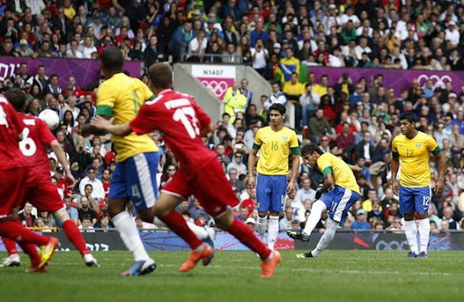 Brazil striker Neymar shoots a free-kick to score against Belarus