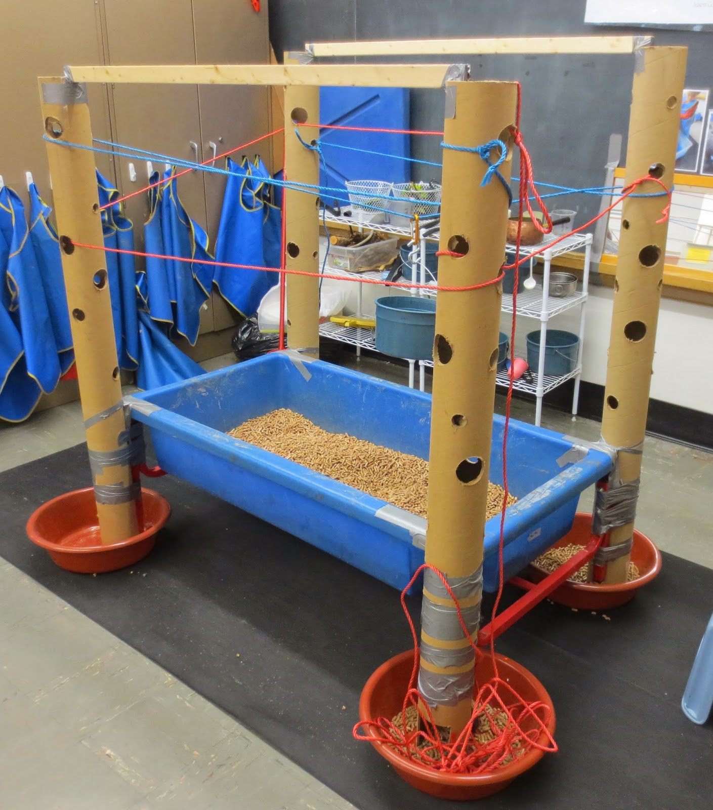 Sand and water tables exploring the vertical tubes with ropes for Html vertical table