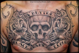 skull and guns tattoo covering a men's chest