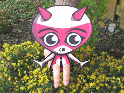 It's a walking wonder Imp Mascot paper cutout toy!