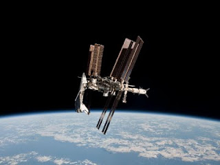 STS-134 Endeavor docked with ISS May 23, 2011 as seen by Soyuz capsule. Image courtesy of NASA.