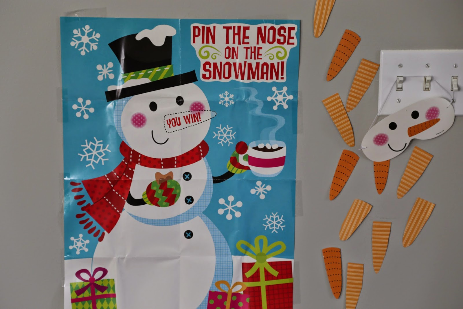 ... draw a snowman on a poster board and cut out carrots from construction