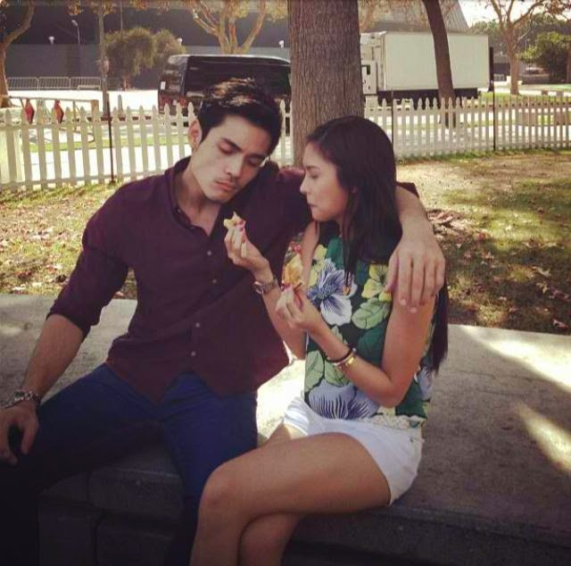 Spotted: Xian Lim's arm around Kim Chiu's shoulders