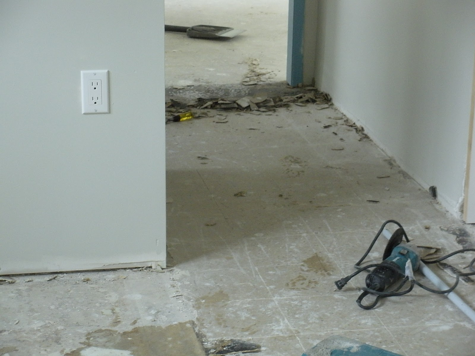 Crafty waffles flat not level old asbestos tiles prepped and ready to skim coat and the living room slope at the doorway dailygadgetfo Choice Image
