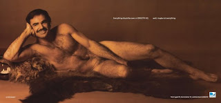 Burt Reynolds reprinted from Cosmo for a DirectTV ad without cigarette or ashtray but still a lot of body hair