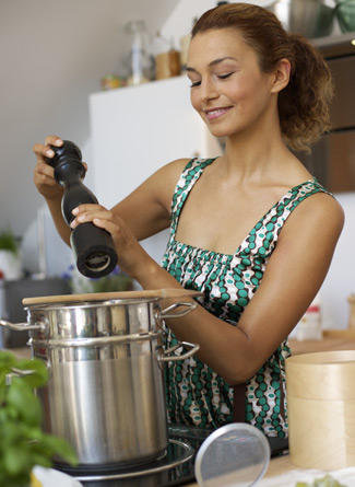 woman-cooking-with-stainless-steel-cookware