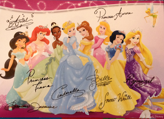 A postcard showing Disney's princesses.