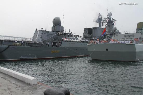 Destroyer Shenyang (R) of the Chinese People's Liberation Army (PLA) Navy is anchored in Vladivostok, Russia, July 5, 2013. Chinese fleet consisting of seven naval vessels arrived in Vladivostok on Friday to participate in Sino-Russian joint naval drills scheduled for July 5 to 12 at the sea area and airspace of the Peter the Great Gulf in the Sea of Japan. (Xinhua/Wang Jingguo)