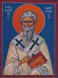 icono de san cipriano que vestido con tunica y un libro en las manos