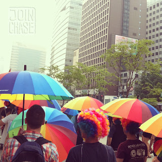 Lots in rainbow umbrellas at the 13th Queer Festival in Seoul, South Korea.