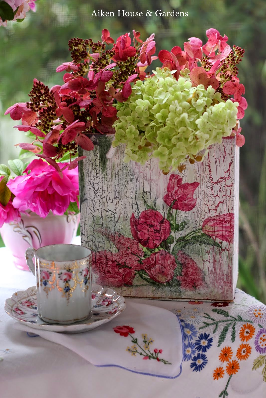 A Lovely Bouquet From The Garden In A Beautiful Pitcher And A Hand  Embroidered Tablecloth.