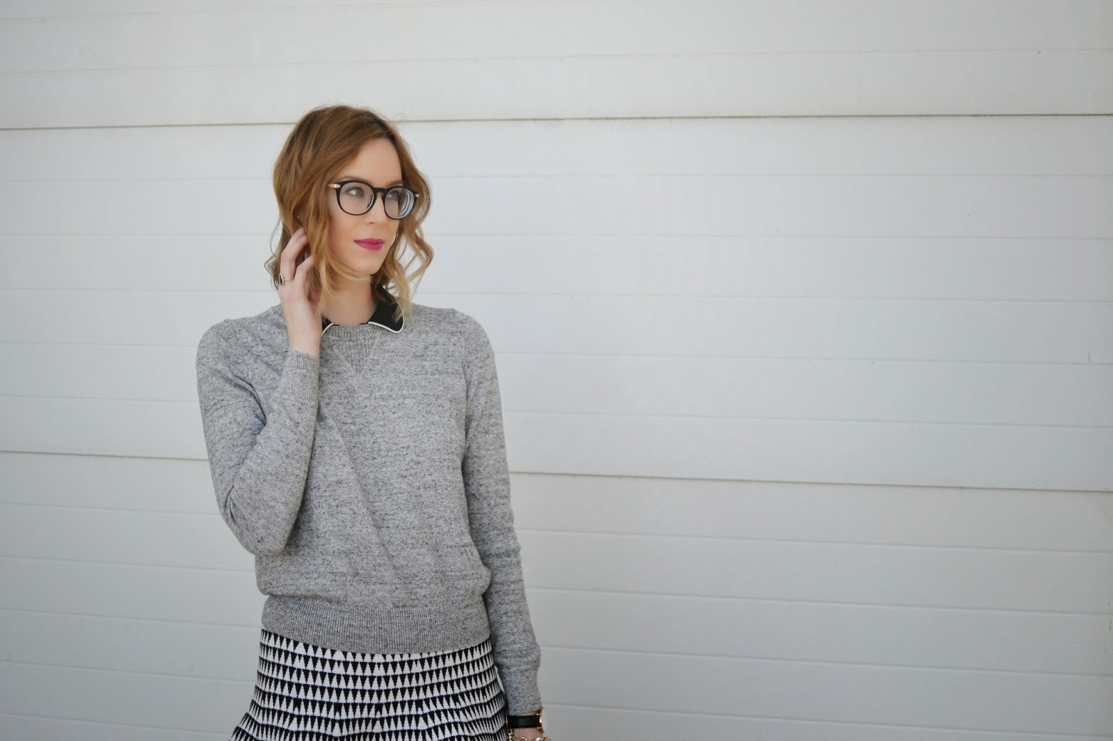 black and white skirt, grey sweater, black collar, black booties, tights, glasses
