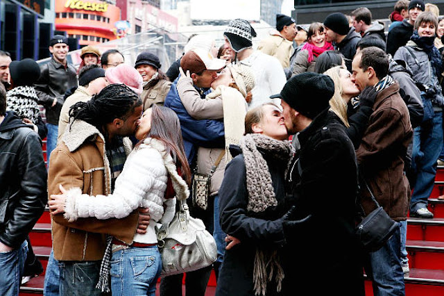 couples kissing in ready for new years eve celebrations