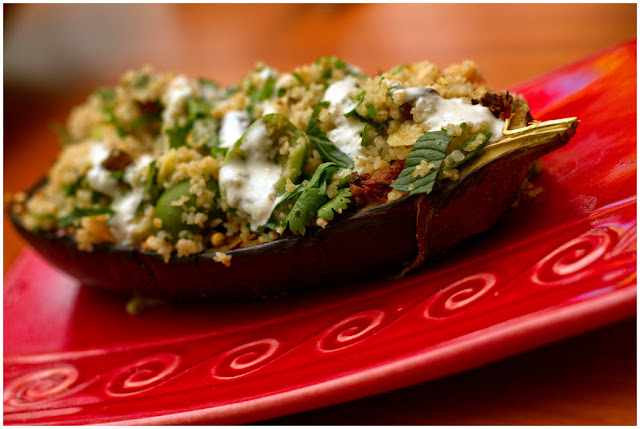 A photograph of Aubergine with Chermoula, Bulgar and Yoghurt.