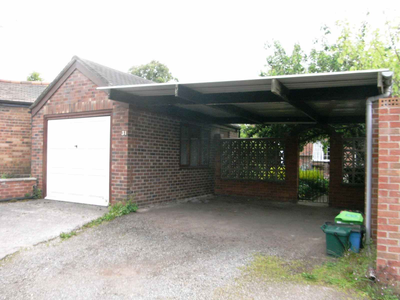 Home for sale for Detached garage with carport