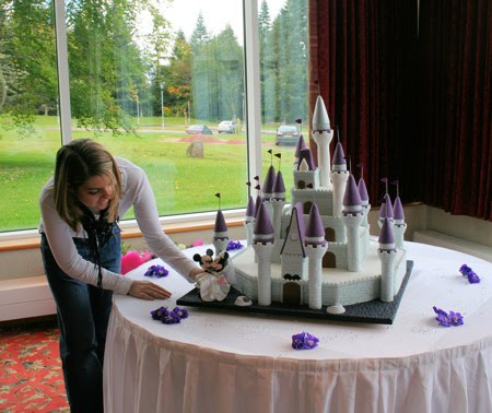 Layers of vanilla and fruit cakes were decorated with deep purple turrets