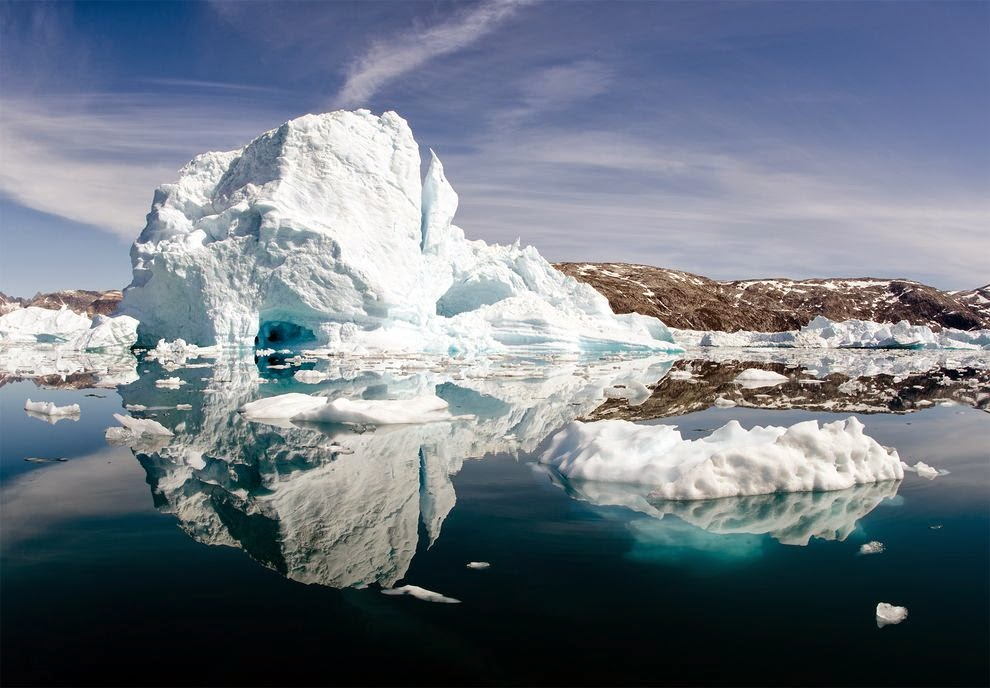 Off the east coast of Greenland, where these icebergs are, salty water sinking into the deep may carry atmospheric heat with it—helping to slow global warming.  (Credit: Patrick Pleul, DPA/Corbis) Click to enlarge.