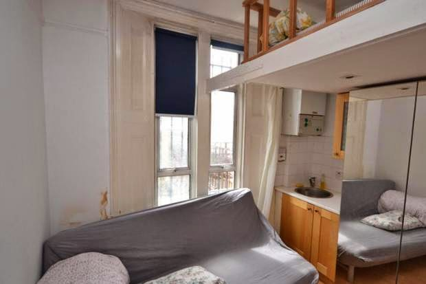 £780 per month for the studio flat where you climb above the fridge to get into bed!