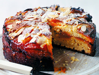 Plum, Almond and Ricotta Cake: Interesting layer cake of an almond, flour and ricotta batter sandwiched with jam that's topped with plums and slivered almonds before baking. Shown with a slice removed